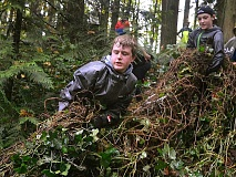SPOKESMAN PHOTO: VERN UYETAKE - Sixth-graders George Heilig, left, and Mitchell Unruh work hard to remove a large section of ivy growth from the woods at Memorial Park.