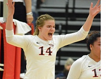 THE OUTLOOK: DAVID BALL - Mt. Hood CC middle blocker Hannah Snyder celebrates a Saints point during Wednesdays four-set home win over Clackamas CC.
