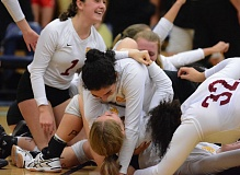 PAMPLIN MEDIA: DAVID BALL - Central Catholics Camille Guerrero celebrates with teammate Tully Bush in a pile up on the floor after the Rams sweep over Clackamas on Saturday night.