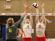 REVIEW/NEWS PHOTO: JIM BESEDA - Clackamas Community College's Madison Anderson (6, white) and Ashley Johnson (10) attempt to block a shot by Chemeketa's Destiny Fahndrich (6, grey) during Wednesday Northwest Athletic Conference volleyball match at Randall Hall.