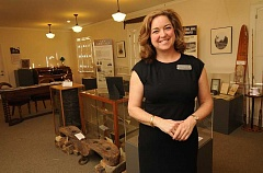 REVIEW PHOTO: VERN UYETAKE - Oswego Heritage Council Executive Director Nany Niland welcomes visitors to the OHC's revitialized and expanded museum at the Oswego Heritage House, 398 10th St. in Lake Oswego.