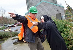 REVIEW PHOTO: VERN UYETAKE - Lake Oswego resident Brian McCarl tries to calm a frantic nun (played by Michelle Hahn) who fears for the safety of trapped earthquake victims during a disaster simulation Saturday in Lake Oswego. It's all part of the city's Community Emergency Response Team training.