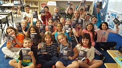 PHOTO COURTESY: LESLIE ROBINETTE - Kaitlyn Gillies' third-grade class shows off their new dictionaries, a gift from the Gladstone/Oak Grove Rotary club.