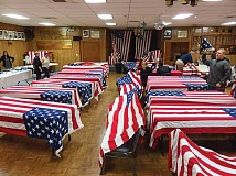 TOM BROWN PHOTO - Flags are dried out on tables at the Madras Elks Lodge before being put away.