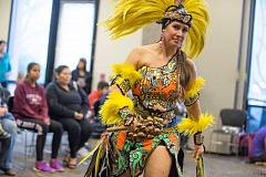 TIMES PHOTO: JONATHAN HOUSE - Kelly Carlos Freeman dances during a performance of the Dance Azteca Huitzilopochtli at Beaverton Library.
