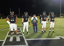 BARBARA SHERMAN - Carl Finley stands with the other Tigard High School captains before their play-off game aganst McNary High School when they were waiting for the coin toss.
