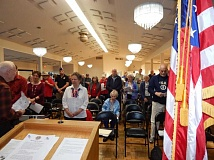 BARBARA SHERMAN - Bob Hamlin (far left) leads those attending King City's Salute to Veterans in singing the different military branches' service songs as part of the event.