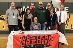 REVIEW/NEWS PHOTO: JIM BESEDA - Putnam High School teachers and adminstrators surround Tyler Creach after she signed a National Letter of Intent Wednesday to play NCAA Division II softball at Western Oregon University in Monmouth.