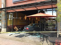 PHOTO COURTESY OF THE TUALATIN POLICE DEPARTMENT - A car driven by a 23-year-old Portland man ended up going through the front of La Sen Vietnamese Grill in Tualatin on Friday morning when, police said, he accidentally hit the gas pedal instead of the brake while trying to park.