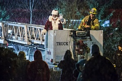 FILE - Santa Claus waves to the crowd from the ladder of a Tualatin Valley Fire & Rescue truck at last year's tree-lighting in downtown Tigard.