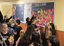 NEWS-TIMES PHOTO: CHASE ALLGOOD - After taking a raucous high-five-filled lap around the halls of Neil Armstrong Middle School,  students hang their paper hands in the hallway.
