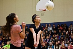 TIMES PHOTO: JAIME VALDEZ - Alexia Castaneda, left, watches her sister, Gessel, hit the ball over the net in a volleyball game against the staff at Twality Middle School.