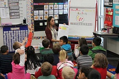SPOKESMAN PHOTO: ANDREW KILSTROM - Lowrie Primary first grade teacher Elisa Lee teaches a math lesson in Spanish. All Lowrie dual language teachers have 15 Spanish-learning students and 15 English-learning students, and also have the help of an instructional assistant.