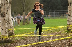 TIDINGS PHOTO: VERN UYETAKE - Athey Creek Middle School eighth-grader Natalie Turner makes her way through an obstacle at Fridays Turkey Trot.