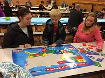 SUBMITTED PHOTO - First-grader Michael Sweeney works with his family to put a puzzle map of the United States together.
