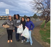 SUBMITTED PHOTO - Kiwanis Key Club members Jade Smith, left, Idallis Ibrahim, Ginny Huang and advisor Patricia Smith who bags of trash they collected.