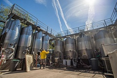 OUTLOOK FILE PHOTO - McMenamins Inc., whose brewery tanks at Edgefield are pictured, is appealing the $62,553 fine the Oregon Department of Environmental Quality issued, claiming the resort discharged wastewater from its brewery/winery into Troutdale creeks without a permit.