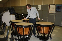 HOLLY SCHOLZ/CENTRAL OREGONIAN - Crook County High School and Middle School band teacher Ken Chaney experiments on the new Yamaha 6300 series timpani drum set. Two grants and a donation made the $12,000 purchase possible.