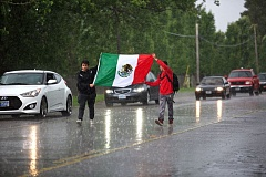 FILE - Tualatin High School students march on Southwest Boones Ferry Road while carrying a Mexican flag during a walkout in May.