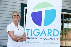 FILE - Debi Mollahan, chief executive officer of the Tigard Chamber of Commerce, poses with the group's logo.