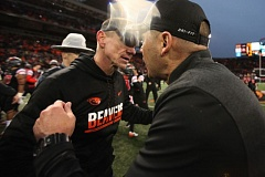 TRIBUNE PHOTO: JAIME VALDEZ - Oregon coach Mark Helfrich (right) congratulates Oregon State's Gary Andersen after the Beavers beat the Ducks on Saturday in Corvallis.