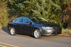 PORTLAND TRIBUNE: JEFF ZURSCHMEIDE - The mid-size Chrysler 200 is a lot of car for the money, with impressive safety rating, the choice of a four- or six-cylinder engine, and available all-wheel-drive.