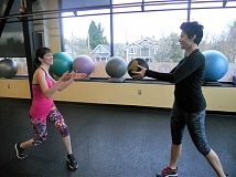 PAMPLIN MEDIA GROUP: SCOTT KEITH - Trainer Jennifer Smirl (right) works with Heather Craig on functional fitness training.