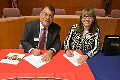PHOTO COURTESY: CCC -  WOU President Rex Fuller (left) and CCC President Joanne Truesdell signed a dual enrollment agreement during a ceremony held Nov. 14 at CCC.