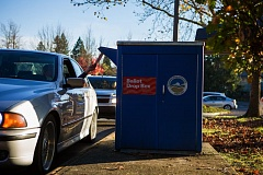 FILE - A voter casts his ballot at the drive-up drop box by Tigard City Hall on Nov. 8.