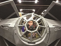 SUBMITTED PHOTO - Canby's Bryce Amiel got a first-hand feel of what it might be like to fly inside a Star Wars Tie-Fighter during this year's Rose City Comic Con. Amiel, who passed away in October, got his wheelchair specially outfitted for the occasion and was a popular participant in the comic con. Earlier in the summer, Amiel was able to meet with Star Wars costume players at a special event at the Charbonneau Country Club.