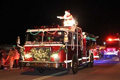 HOLLY M. GILL - Santa arrives on the top of a fire truck during last year's Christmas Lights Parade.