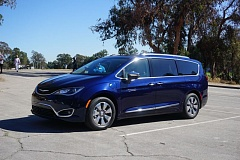 PORTLAND TRIBUNE : JEFF ZURSCHMEIDE - The plug-in hybrid version of the Chrylser Pacifica can travel about 33 miles on elecricity alone before converting over to a convention hybrid mode.