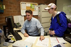 PHOTO COURTESY: LORI HALL - Veterans affairs coordinator RB Green helps a CCC student in the college's VET Center in Oregon City.