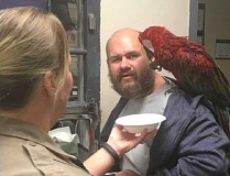 WCSO - Craig Buckner appears with his macaw, Bird, after being arrested in the Washington County Circuit Court.