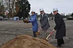 NEWS-TIMES PHOTO: MICHELLE THOMAS - (Left to right) Metro Councilor Kathryn Harrington, Mayor Pete Truax and Tokola Owner Dwight Unti picked up their golden shovels.