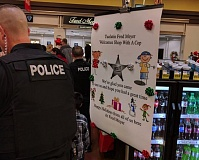 COURTESY OF THE TUALATIN COMMUNITY POLICE FOUNDATION - Children in need got to do some holiday shopping with police officers at the Tualatin Fred Meyer on Thursday.