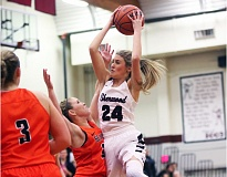 DAN BROOD - Sherwood sophomore Aubrie Emmons (24) looks to go to the basket during the Lady Bowmen's 55-17 win over Beaverton on Friday.