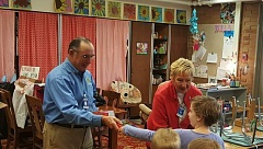 PHOTO COURTESY: HEATHER HOBSON - Rotarians Mike Smith and Ronda Butler providing dictionaries to students in the North Clackamas School District.