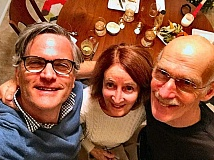 COURTESY OF SAM ADAMS - Sam Adams, home in November for a Thanksgiving visit, is shown with his Woodstock parents: His mother Karalie Adams; and his stepfather Stewart Buettner. Sam evidently took this picture while holding his phone somewhere near the ceiling!