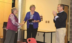 SUBMITTED PHOTO - Sande Ely (middle) receives the November CARE award plaque recently. She is a key program skills trainer as Baker Prairie Middle School.