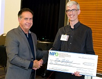 SUBMITTED PHOTO - Nurse Practitioners of Oregon Chairman James Sims (left) awards the 2016 NPO Nanette Clapper Memorial Scholarship to Portland doctoral student and nurse practitioner Tim Gebhart.
