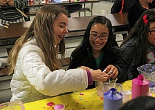 JULIA COMNES - Students make slime out of borax, glue and paint, following instructions provided by volunteers.