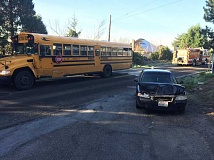 SUBMITTED PHOTO - A car struck a bus carrying students bound for Jackson Middle School on Wednesday morning on Lesser Road near the Westlake Drive.
