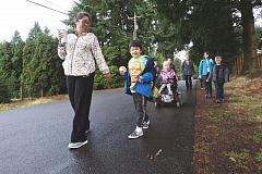 TIMES PHOTO BY JAIME VALDEZ - Elementary schoolers across the Tigard-Tualatin School District celebrated Walk and Bike to School Day in October
