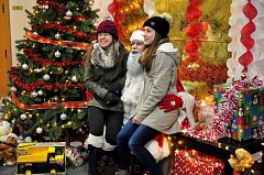 SPOKESMAN PHOTOS: LESLIE PUGMIRE HOLE - Wood Middle School student Victoria Gridinar, 13 (left) joins friend Kaitlyn Shkutnik, 14, of Woodburn for a photo opp with Santa Nov. 30 at Wilsonvilles Tree Lighting ceremony in Town Center Park.