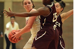 THE OUTLOOK: DAVID BALL - Mt. Hood CC guard Jessica Parker looks for a passing lane, while Pierce closes in with a double-team effort.