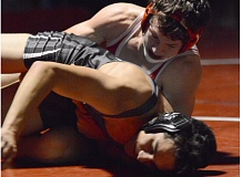 THE OUTLOOK: DAVID BALL - Centennials Seth Sherell keeps his opponent on the mat on his way to a 10-1 major decision at 145 pounds.