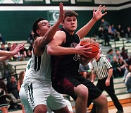 DAN BROOD - Sherwood High School senior Luka Nixon (right), shown here in a game last year, is one of the top returnees for the Bowmen this season.