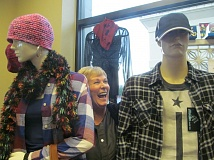 PHOTO BY ELLEN SPITALERI - Patti Serres, executive director of Building Blocks 4 Kids, shares a laugh with Ben and Barbie, mannequins dressed in new clothes at the Bloomin' Boutique in Oregon City.