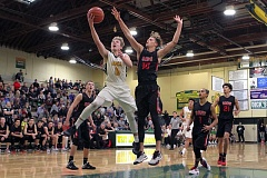 TIDINGS PHOTO: MILES VANCE - West Linn's Braden Olsen goes to the basket during his team's 83-69 win over Clackamas at West Linn High School on Tuesday.